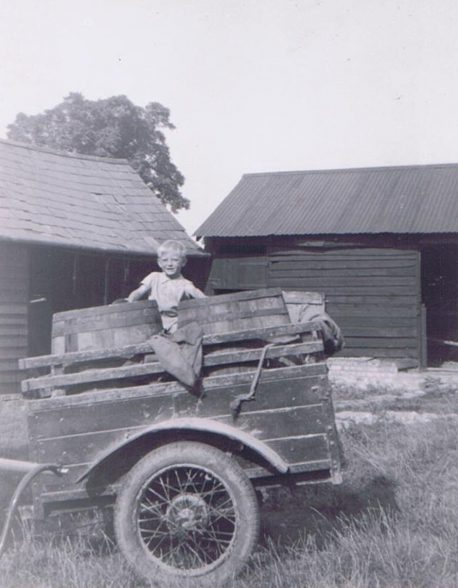 Christopher Lake in the cart in the farmyard of 28 Shillington Rd.