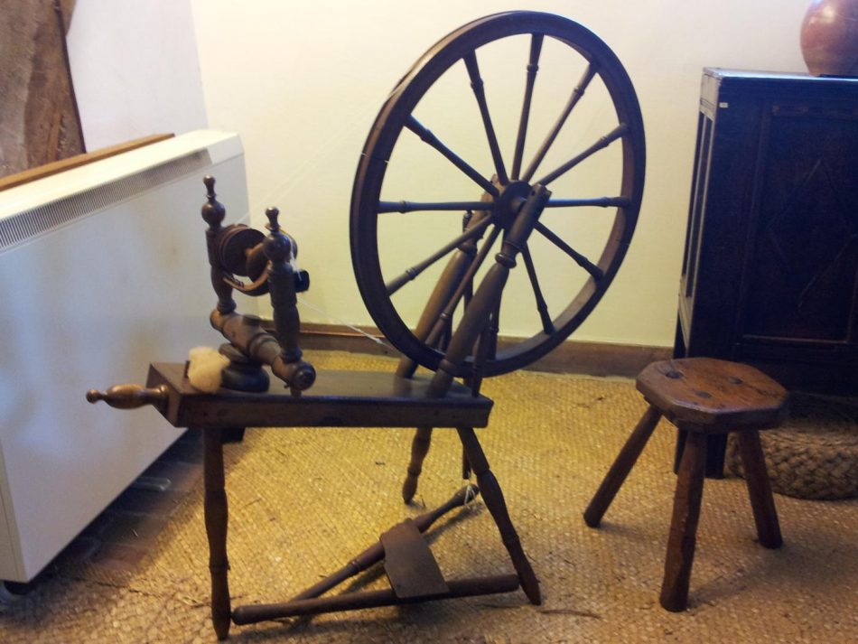Spinning wheels were used to spin wool and flax for linen.