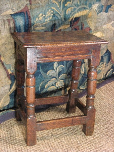 A jointed stool with sophisticated joints. It was made by a joiner rather than a carpenter.