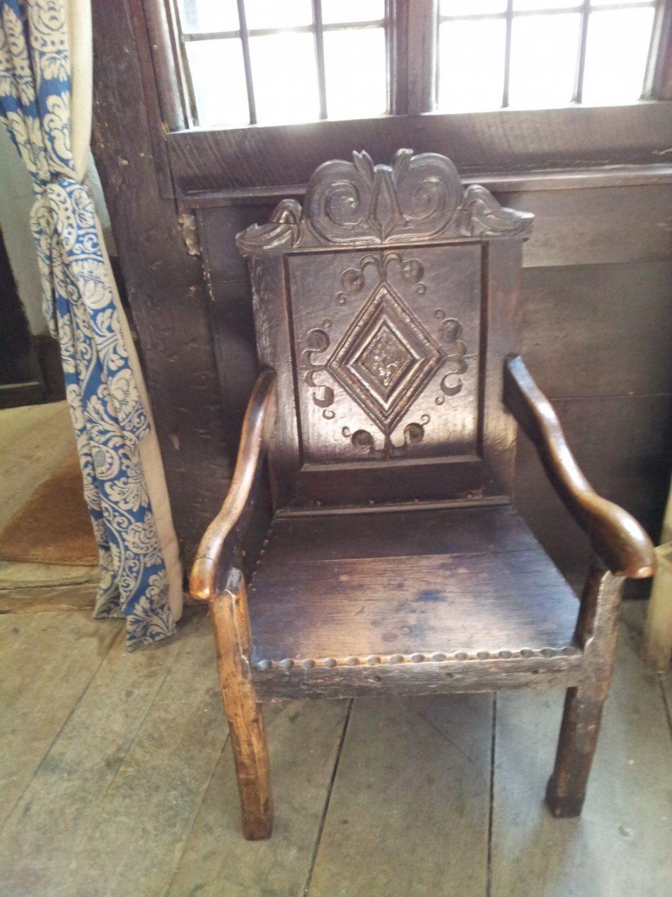 A carved armchair.