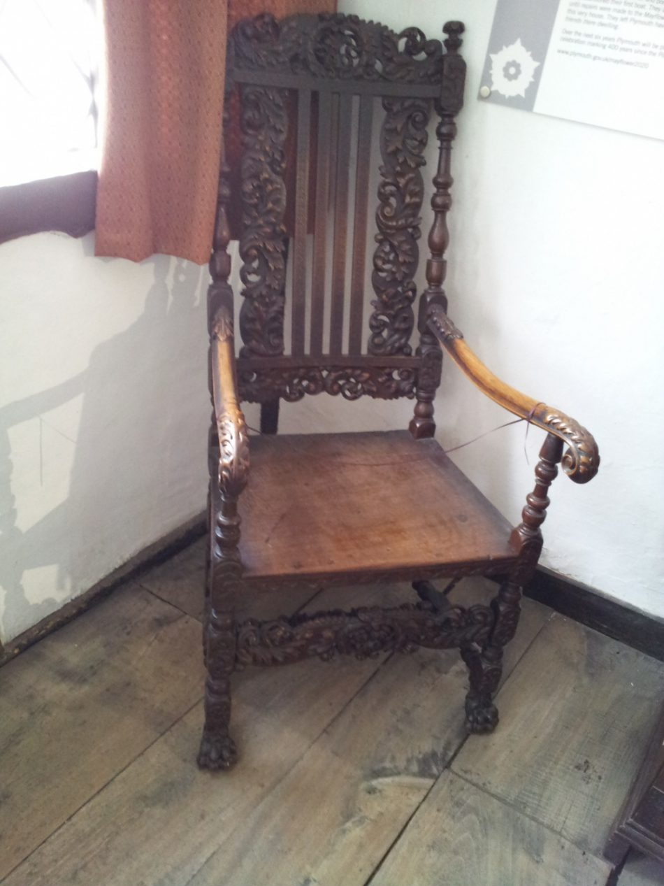An elaborate carved chair.